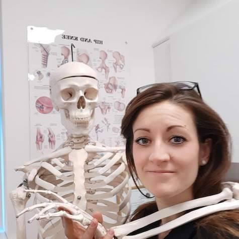 Emily standing with a skeleton